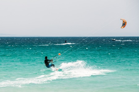 kitesurfing: Tarifa, Spain - June 21, 2015: Kite surfing in Tarifa, Spain. Tarifa is most popular places in Spain for kitesurfing.