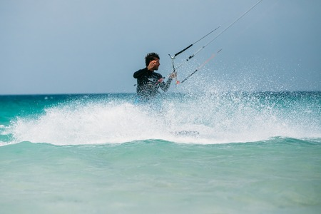 kitesurfing: Tarifa, Spain - June 21, 2015: Kite surfing in Tarifa, Spain. Tarifa is most popular places in Spain for kitesurfing Editorial