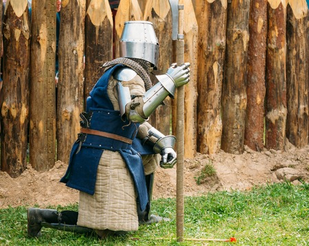 siege: MINSK, BELARUS - JULY 19, 2014: Historical restoration of knightly fights on festival of medieval culture. The siege of wooden fortress