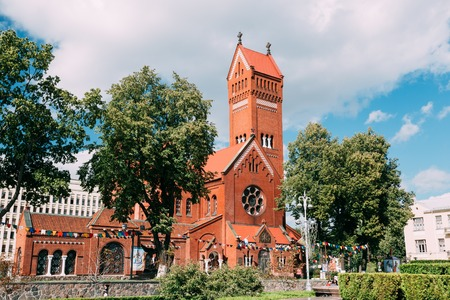 helen: MINSK, BELARUS - AUGUST 27, 2014: Belarussian Roman Catholic Church Of Saints Simon And Helen or Red Church On Independence Square In Minsk, Belarus Stock Photo