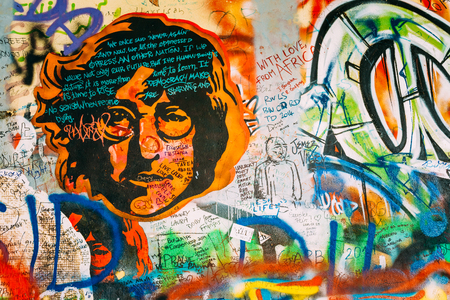 Prague, Czech Republic - October 10, 2014: Famous place in Prague - The John Lennon Wall. Wall is filled with John Lennon inspired graffiti and lyrics from Beatles songs