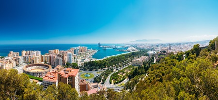 Panorama cityscape aerial view of Malaga, Spain. Plaza de Toros de Ronda bullring in Malaga, Spain. 스톡 콘텐츠
