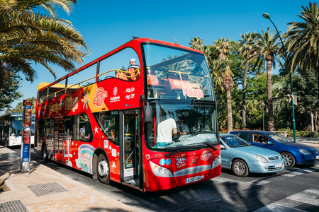 open topped: Malaga, Spain - June 23, 2015: Touristic bus on street. City sightseeing Malaga is a new official touristic bus service that shows the city.