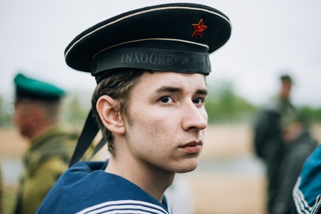 re enactment: MOGILEV, BELARUS - MAY, 08, 2015: Unidentified re-enactor dressed as Soviet sailor during events dedicated to 70th anniversary of the Victory of the Soviet people in the Great Patriotic War.