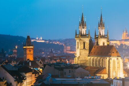 old town hall: Night cityscape of Prague, Czech Republic. Famous Old town hall, Church Of Our Lady Before Tyn.