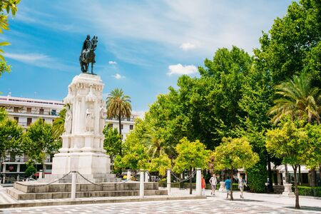 ferdinand: Seville, Spain - June 24, 2015: Monument to King Saint Ferdinand at New Square or Plaza Nueva in Seville, Spain.