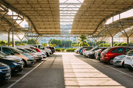 lot of: Fuengirola, Spain - June 24, 2015: Cars on a parking lot in sunny summer day