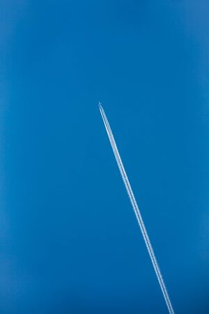 pollution free: Contrail In Blue Sky. Plane, aircraft, airplane In Sky With Plane Trails.
