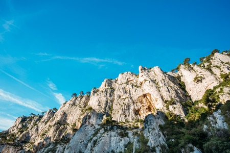 azure coast: Beautiful nature of Calanques on the azure coast of France. High cliffs under blue sunny sky.