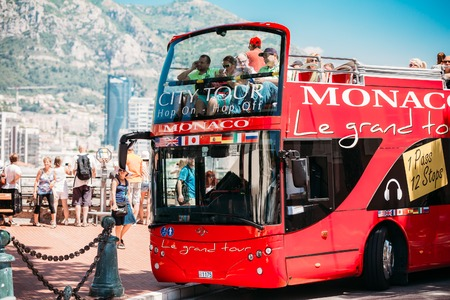open topped: Monte Carlo, Monaco - June 28, 2015: Touristic bus on street. Le grand tour is a official touristic bus service that shows the city.
