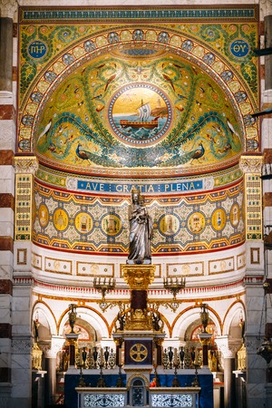 frescoed: Marseille, France  - June 30, 2015: Frescoed wall and altar in Catholic basilica Notre Dame De La Garde church. Architect H.J.Esprandieu