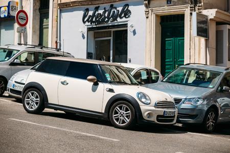 Marseille, France  - June 30, 2015: White color Mini Cooper on street