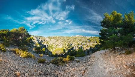 azure coast: Panorama of beautiful nature of Calanques on the azure coast of France. High cliffs under blue sunny sky.