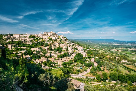 gordes: Beautiful scenic view of medieval hilltop village of Gordes in Provence, France. Blue sunny summer sky