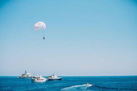 water sports: Parasailing in open sea. Active water sports