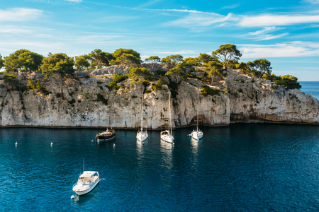 azure coast: Beautiful nature of Calanques on the azure coast of France. Calanques - a deep bay surrounded by high cliffs. Yacht boats in bay Stock Photo