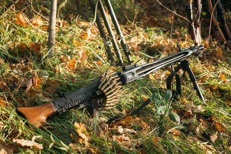 wehrmacht: German military ammunition - machine gun of World War II on grass ground Stock Photo