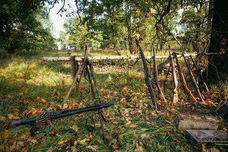 reenactmant: German and Soviet russian military ammunition of World War II in forest camp reenactors.