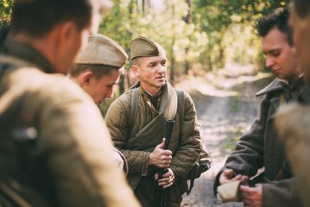 re enaction: Teryuha, Belarus - October 3, 2015: Group unidentified re-enactors dressed as Soviet soldiers Editorial