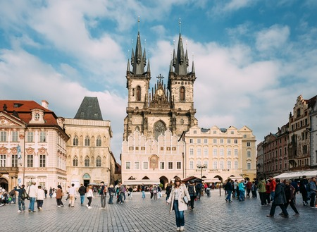 old town square: Prague, Czech Republic - October 13, 2014: Tourists walking on old square on background of the Church Of Our Lady Before Tyn In Old Town Square Editorial