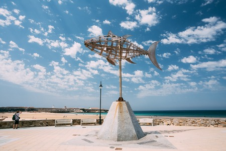 windward: Tarifa, Spain - June 21, 2015: Weather vane in shape tuna on background sunny landscape in Tarifa, Spain. Designed by Pedro L.Barbera. Editorial