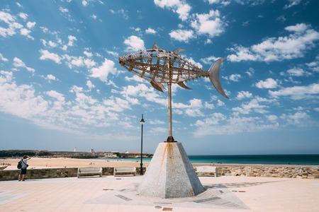windward: Tarifa, Spain - June 21, 2015: Weather vane in shape tuna on background sunny landscape in Tarifa, Spain. Designed by Pedro L.Barbera. Editorial