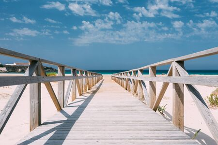 Wooden Path, Stairs On Beach Dunes In Tarifa, Andalusia, Spain. Holiday, vacation, travel at sea background.