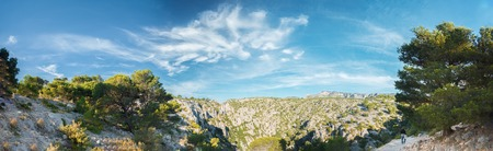 azure coast: Panorama of summer nature of Calanques on the azure coast of France. High cliffs under blue sunny sky.