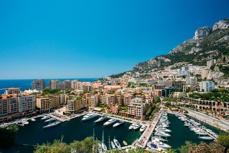 monte carlo: Yachts moored near city Pier, Jetty In Sunny Summer Day. Monaco, Monte Carlo architecture. Stock Photo