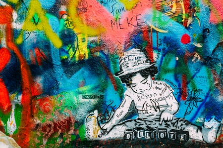 lyrics: Prague, Czech Republic - October 10, 2014: Famous place in Prague - The John Lennon Wall. Wall is filled with John Lennon inspired graffiti and lyrics from Beatles songs