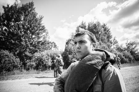reenaction: SVETLAHORSK, BELARUS - JUNE 21, 2014: Unidentified re-enactors dressed as Soviet Russian soldiers during events dedicated to 70th anniversary of Soviet Belorussian offensive operation Bagration