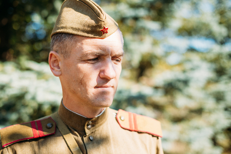 reenactor: Teryuha, Belarus - October 3, 2015: Close up portrait of unidentified re-enactor dressed as World War II Soviet russian soldier in forest Editorial