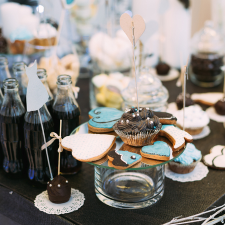 Dessert Sweet Cookies in shape of a star, heart and a boot in Candy Bar On Table. Delicious sweet buffet. Stock Photo