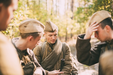 reenactor: Teryuha, Belarus - October 3, 2015: Portrait of unidentified re-enactor dressed as World War II Soviet russian soldier in forest