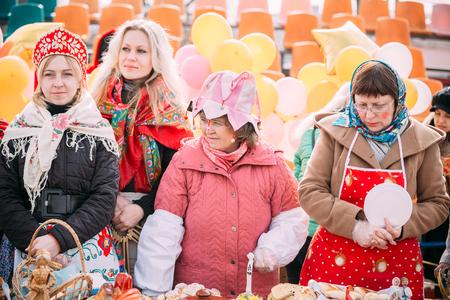 maslenitsa: Gomel, Belarus - March 12, 2016: Four unknown beautiful women trading pastry at Celebration of Maslenitsa Shrovetide holiday