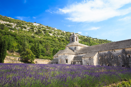 Beautiful landscape lavender field and an ancient monastery abbey Abbaye Notre-Dame de Senanque in Vaucluse, France Stock Photo