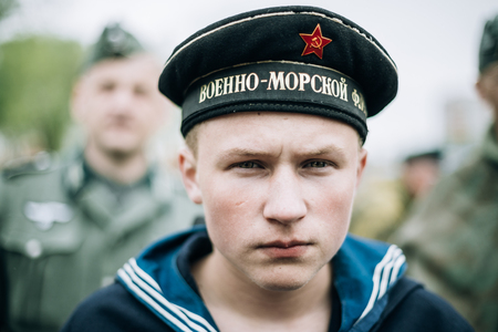 reenactor: Mogilev, Belarus - May 08, 2015: Unidentified re-enactor dressed as Soviet sailor during events dedicated to 70th anniversary of the Victory of the Soviet people in the Great Patriotic War.