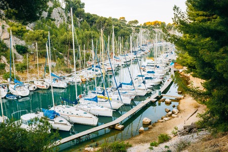 azure coast: Many White Yachts Boats Moored In Bay. Calanques - A Deep Bay Surrounded By High Cliffs In The Azure Coast Of France