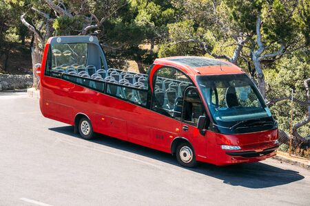 open topped: Touristic bus on street. Touristic bus service that shows the city. Stock Photo