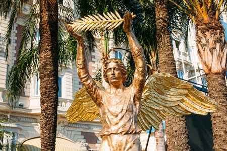 palm branch: Cannes, France - June 28, 2015: Bronze statue of an angel with a palm branch at the InterContinental Carlton Cannes hotel.