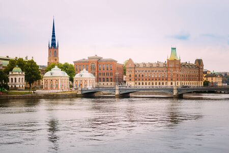 gamla stan: Stockholm, Sweden. The Vasa Bridge To Gamla Stan Over Norrstrom, With The Riddarholmen Church Tower On Background. Stock Photo