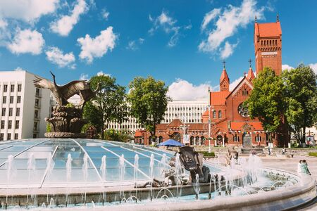 places of worship: Church Of Saints Simon And Helen or Red Church And Fountain At Independence Square In Minsk, Belarus
