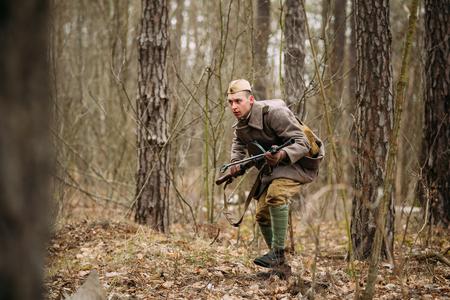 reenactor: Pribor, Belarus - April, 05, 2015: Unidentified Re-enactor Dressed As Soviet Russian Soldier Running Through Woods