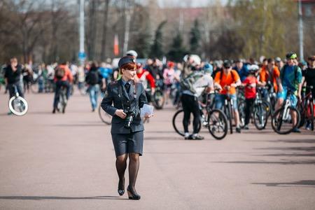 female police: Gomel, Belarus - April 10, 2015: Young female police officer is on Lenin Square in Homel