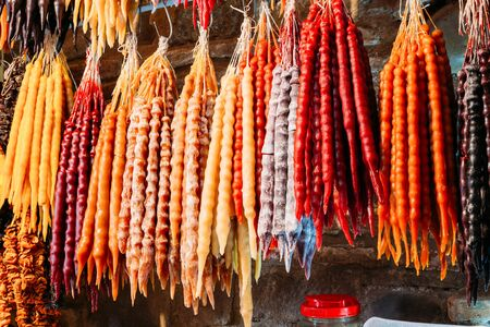 Churchkhela Is A Traditional Georgian Sausage-shaped Candy. The Main Ingredients Are Grape Must, Nuts And Flour.