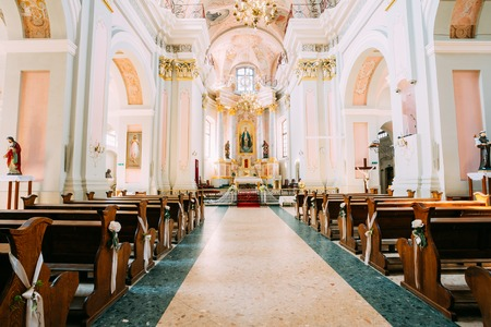 Minsk, Belarus - May 20, 2015: Interior of Cathedral of Saint Virgin Mary in Minsk, Belarus. Church pews and altar