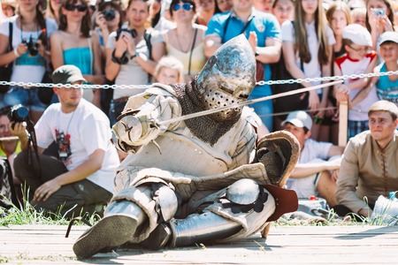 chivalry: Dudutki, Belarus - July19, 2014: Historical restoration of knightly fights on festival of medieval culture