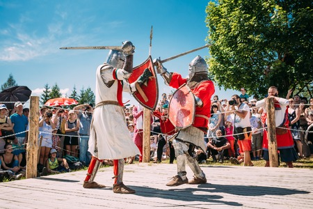 chivalry: Dudutki, Belarus - July19, 2014: Historical restoration of knightly fights on festival of medieval culture. Knights In Fight With Swords