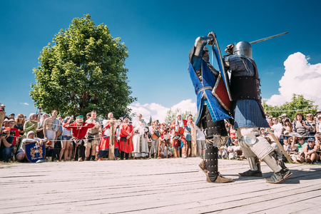 knightly: Dudutki, Belarus - July19, 2014: Historical restoration of knightly fights on festival of medieval culture. Knights In Fight With Swords