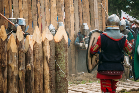 siege: Dudutki, Belarus - July19, 2014: Historical restoration of knightly fights on festival of medieval culture. The siege of wooden fortress